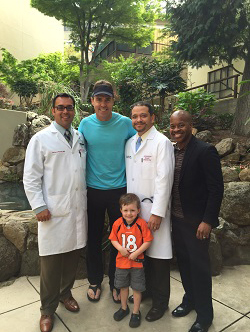 Richard Parent, MD, general & bariatric surgeon, Bill Romanowski, former NFL linebacker, Stewart Allen, MD, interventional cardiologist, and Dr. Corey Warner, internal medicine specialist, Jesse Velderrain, a young Bronco fan.