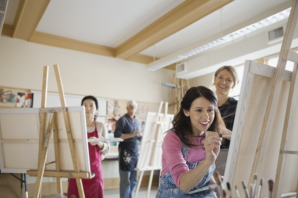group of people in a studio painting
