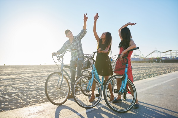 three adult friends riding bikes