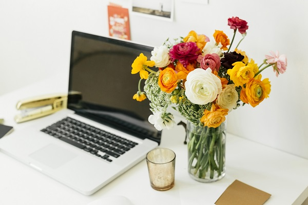 vase of flowers on a work desk