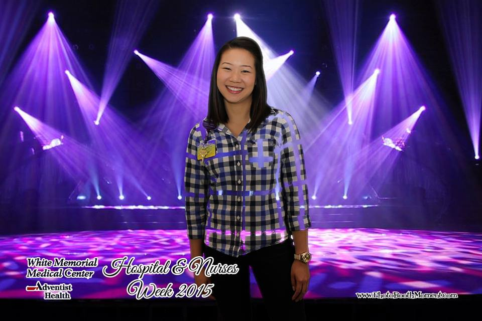 nurse posing in front of purple stage background