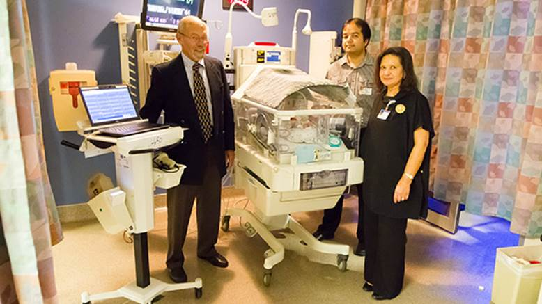 physicians and nurse in NICU room