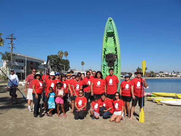 group of white memorial employees and family kayaking