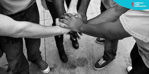 close up of group with hands in the middle of circle