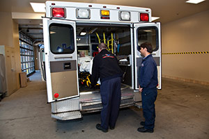 Emergency care providers loading equipment into ambulance