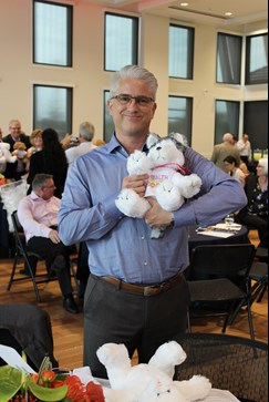 man holding teddy bear