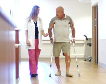 PT and patient walking