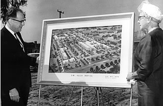 William H. Gosse, the first administrator of Simi Valley Community Hospital, reviews an artist's rendering of building plans with Honorary Mayor Mrs. Lou Wright.