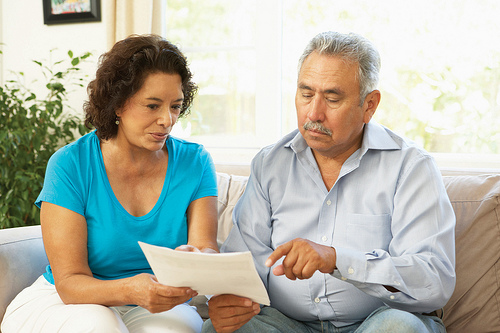 Man and Woman reviewing health care options