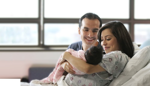 husband and wife with newborn
